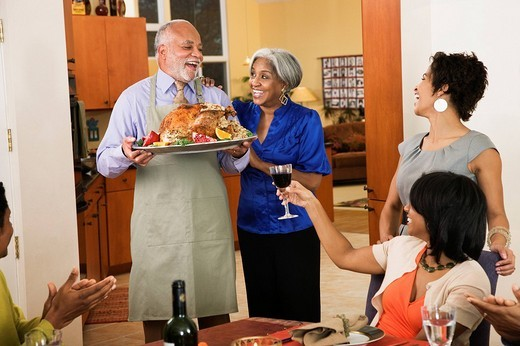 African American man serving Thanksgiving turkey : Stock Photo