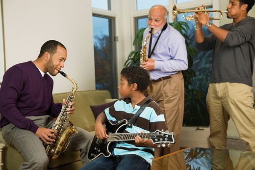 African American family playing musical instruments together : Stock Photo