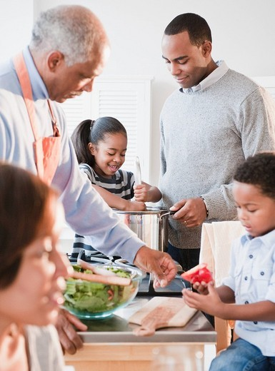 African American family cooking together : Stock Photo