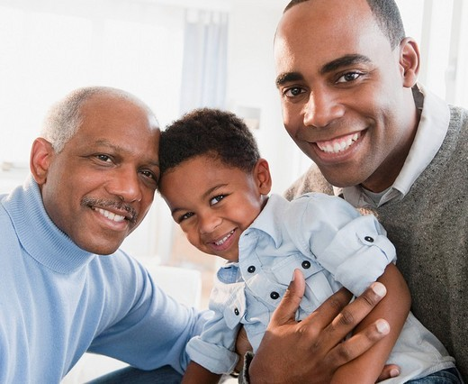 African American grandfather smiling with son and grandson : Stock Photo