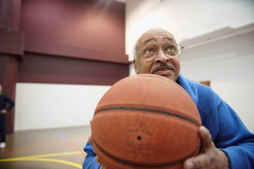Senior African American playing basketball : Stock Photo