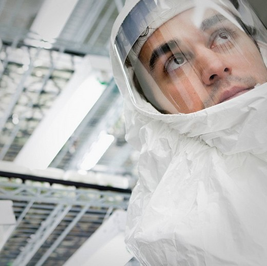 Middle Eastern scientist in clean suit in laboratory : Stock Photo