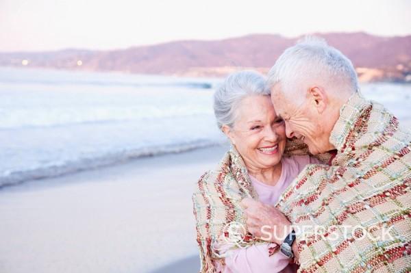 Stock Photo: 1589-131419 Senior Caucasian couple standing on beach