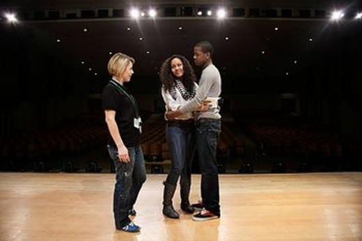 Students rehearsing onstage : Stock Photo