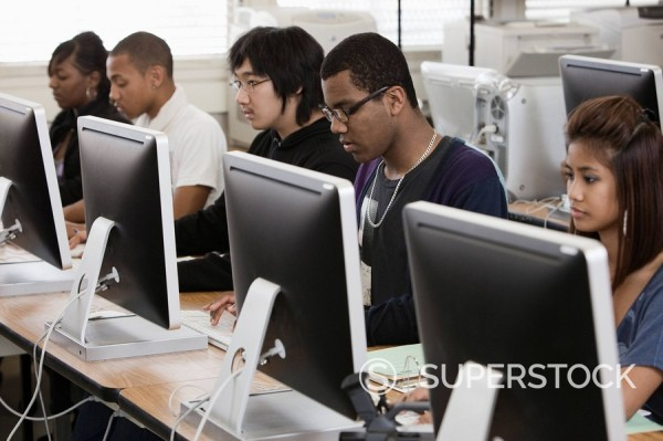 Students working in computer lab : Stock Photo