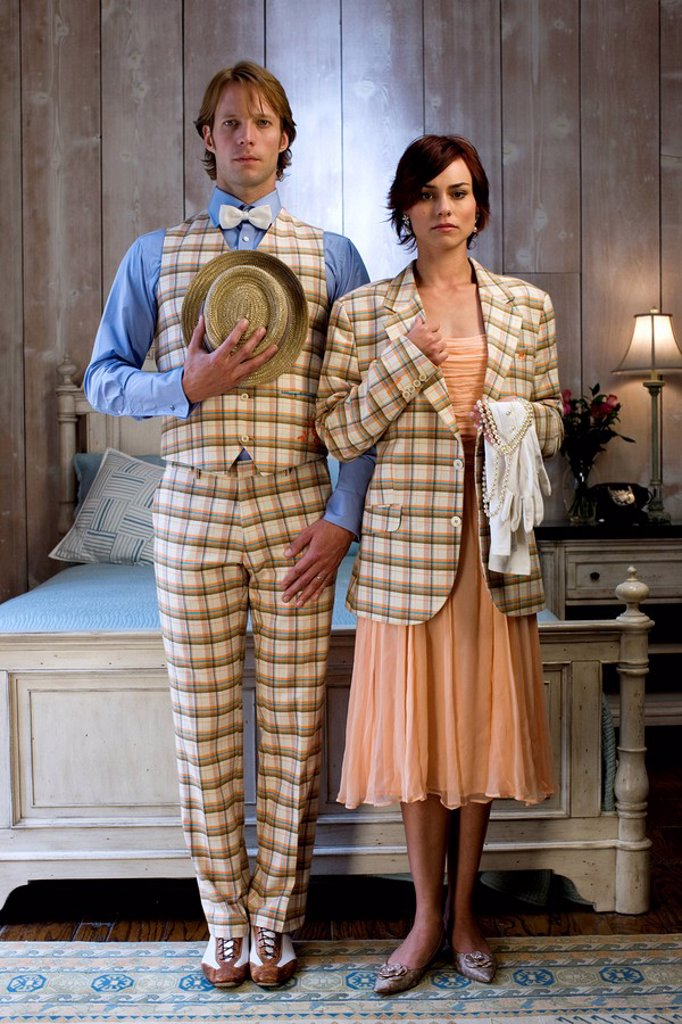 Stock Photo: 1589-133531 Elegant couple standing in bedroom in evening clothes