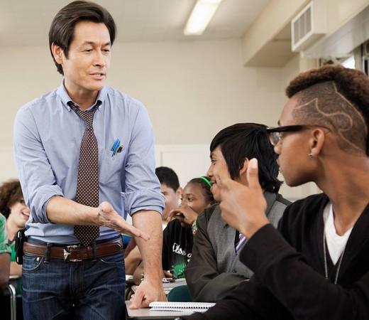 High school students listening to teacher : Stock Photo