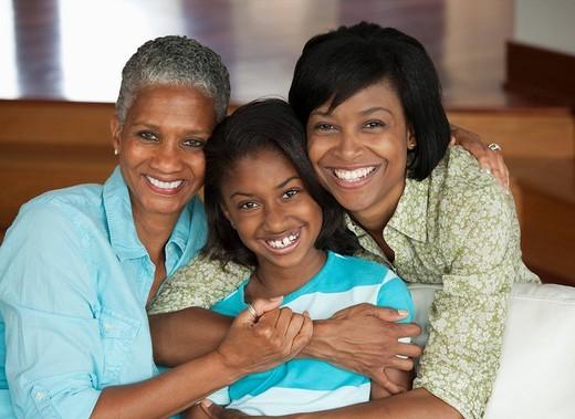 Multi_generation Black family hugging : Stock Photo