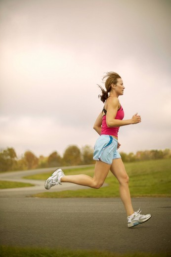 Woman jogging on path : Stock Photo
