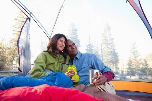 Couple camping and cuddling in tent : Stock Photo