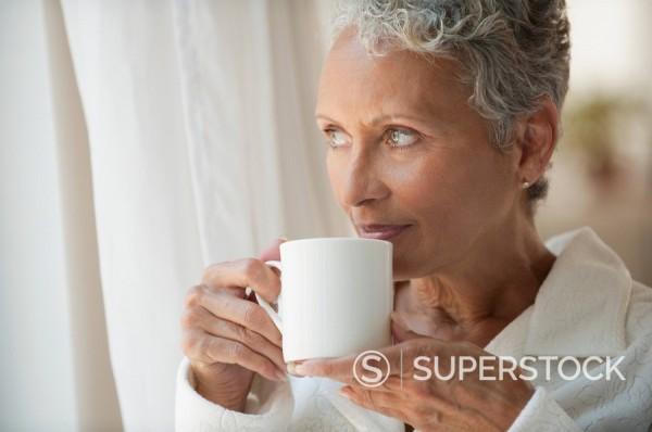 African American woman drinking coffee : Stock Photo