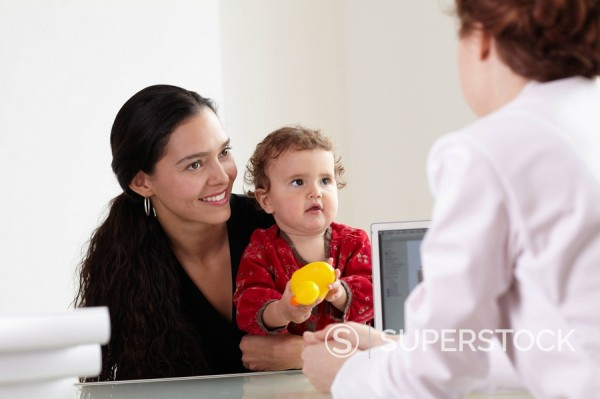 Mother and child with doctor : Stock Photo
