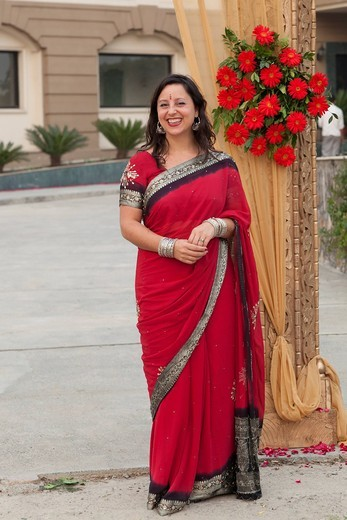 Smiling mixed race woman in Indian clothing : Stock Photo