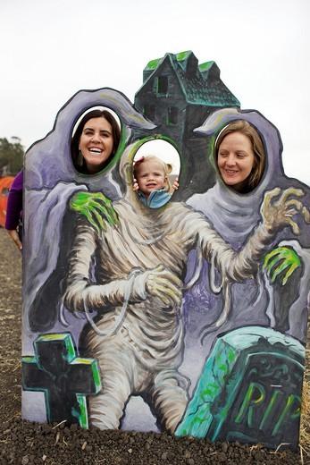 Family enjoying Halloween decoration : Stock Photo