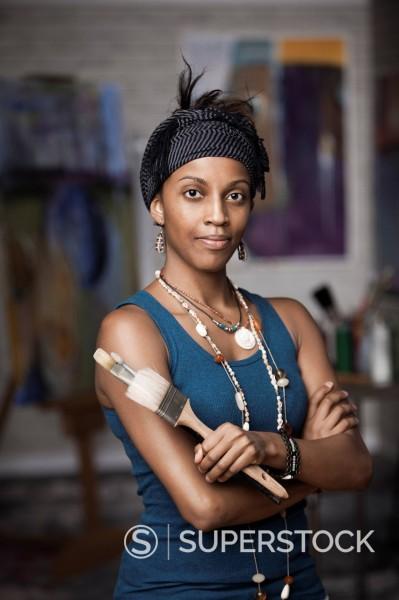 Stock Photo: 1589-142027 Mixed race woman standing in artist´s studio