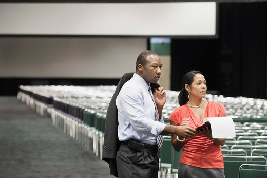 Black businesspeople talking in conference center : Stock Photo