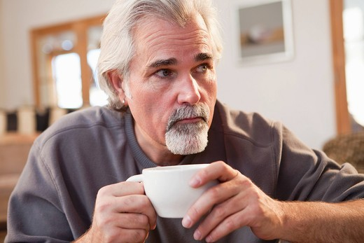 Caucasian man drinking coffee : Stock Photo