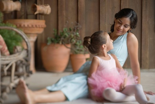 Mother sitting on porch with ballerina daughter : Stock Photo