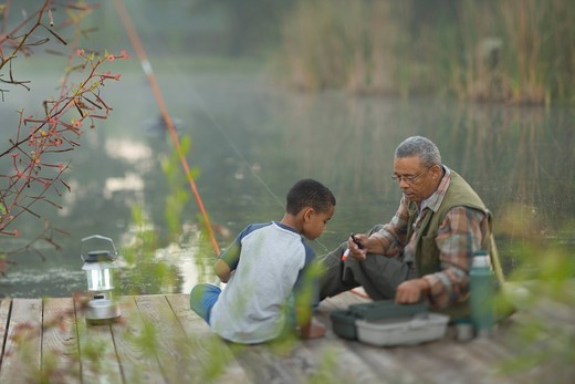 Grandfather and grandson fishing on pier : Stock Photo