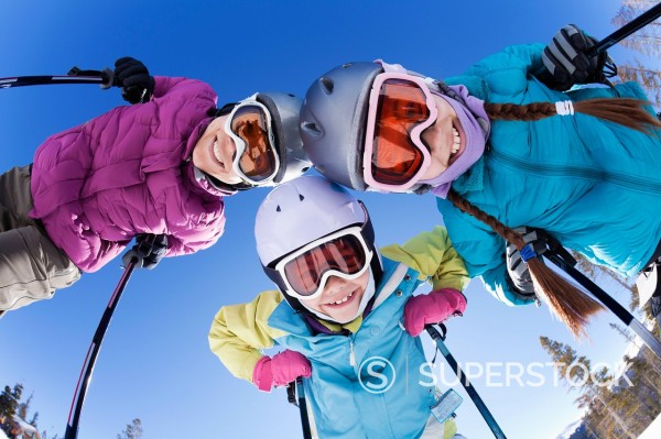 Grinning family skiing together : Stock Photo