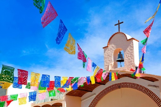 Colorful flags decorating church : Stock Photo
