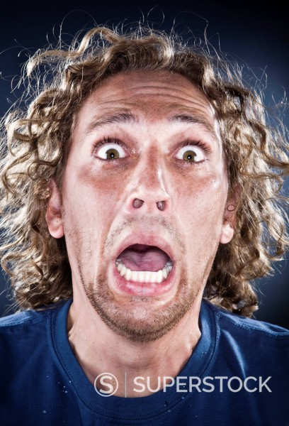 Stock Photo: 1589-142753 Scared Caucasian man shouting