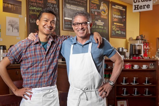 Partners of cafe standing together : Stock Photo