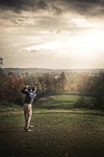 Caucasian man playing golf : Stock Photo