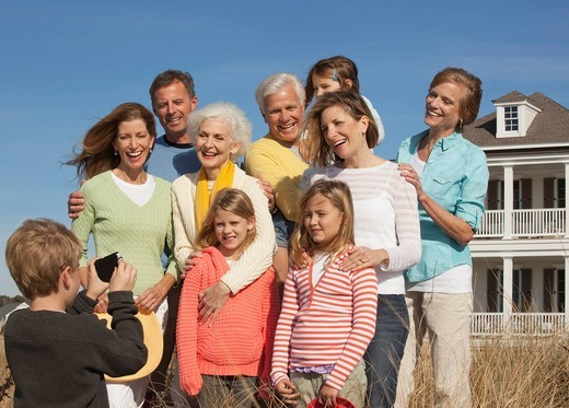 Caucasian family posing for photograph : Stock Photo