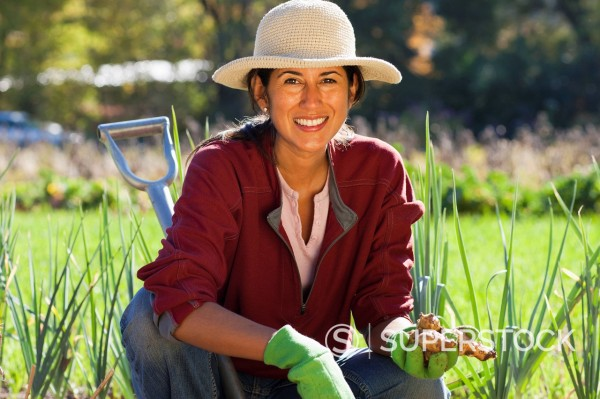 Ecuadorian woman gardening : Stock Photo