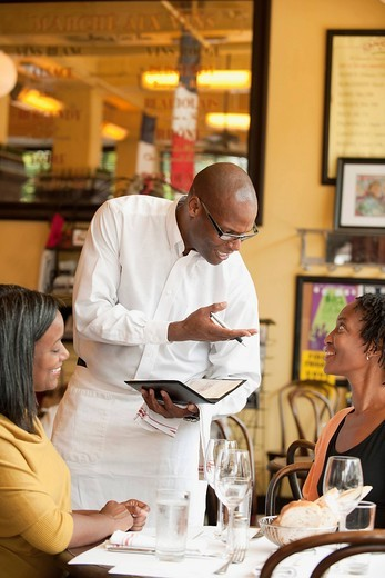 African American friends having lunch in restaurant : Stock Photo