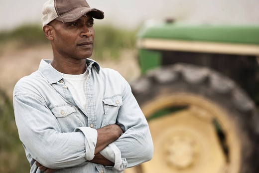 African American farmer with arms crossed : Stock Photo