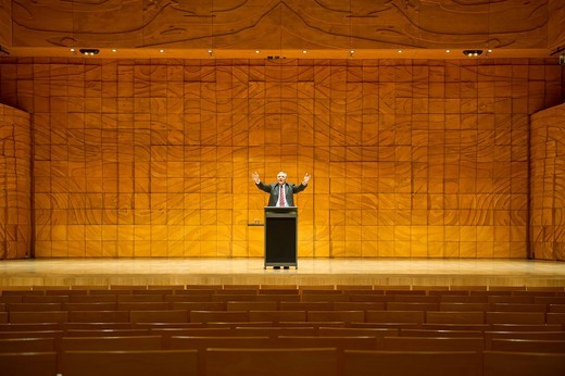 Caucasian businessman practicing speech in empty auditorium : Stock Photo