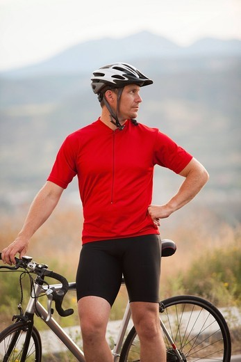 Caucasian man standing near bicycle : Stock Photo