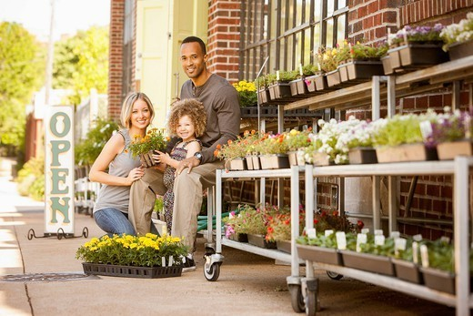 Family at florist shop : Stock Photo