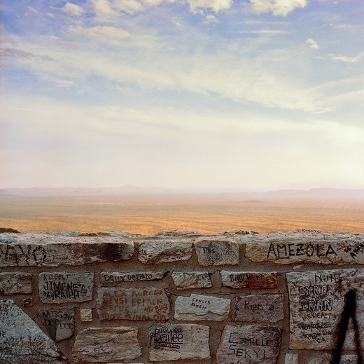 Graffiti on wall with desert in background : Stock Photo