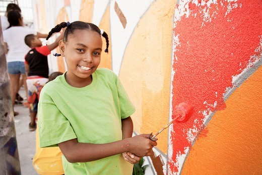 Girl painting wall : Stock Photo