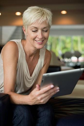 Caucasian woman using digital tablet : Stock Photo