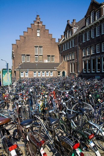 Bicycles parked in Dutch plaza : Stock Photo