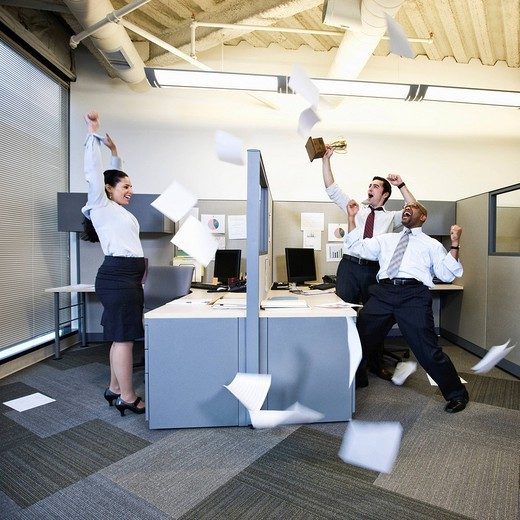 Business people cheering in cubicles : Stock Photo