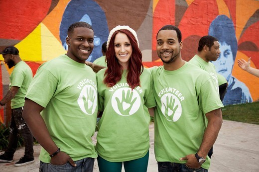 Volunteers standing together : Stock Photo