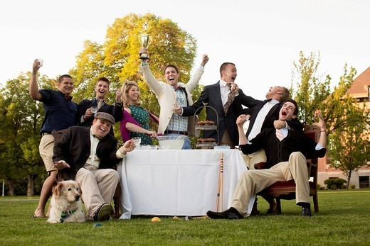 Friends enjoying elegant lawn party : Stock Photo