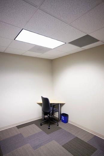 Desk in corner of office : Stock Photo