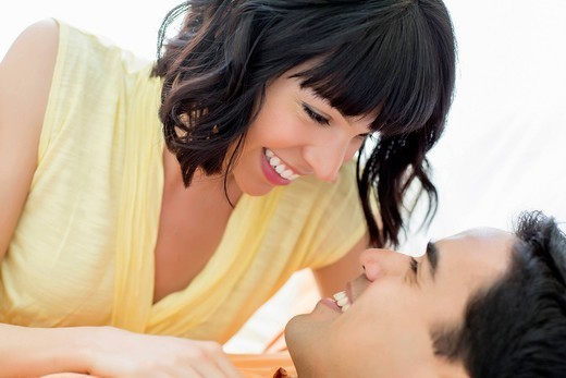 Couple smiling at one another : Stock Photo