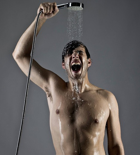 Caucasian man taking a shower : Stock Photo