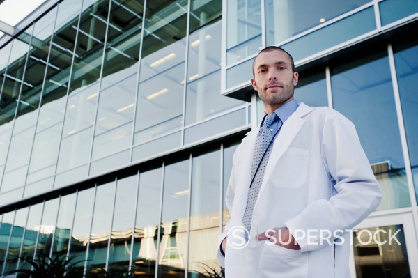 Stock Photo: 1589-163491 Serious doctor standing outdoors