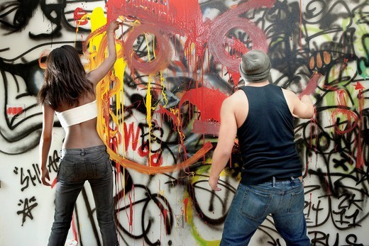 People tagging wall with graffiti : Stock Photo