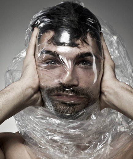 Man wrapped in plastic : Stock Photo