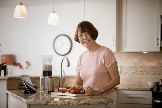 Asian woman preparing food : Stock Photo