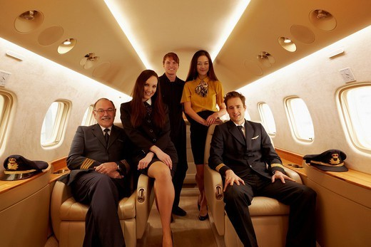 Pilots and fight staff in private jet : Stock Photo